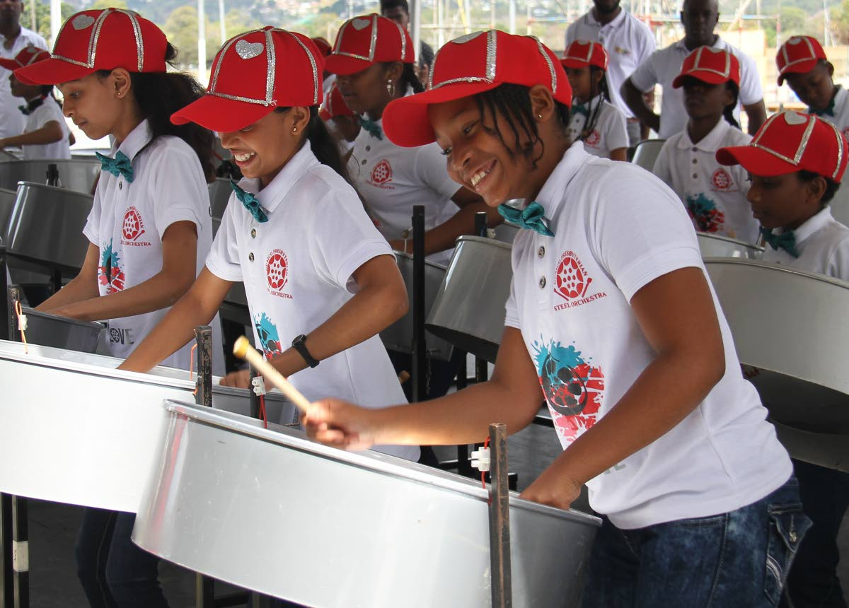 PAN SMILES: Students from Guaico Presbyterian Primary enjoyed themselves yesterday at the Education Ministry's inaugural Schools Champs in Concert show at the Queen's Park Savannah in Port of Spain. PHOTO BY AYANNA KINSALE
