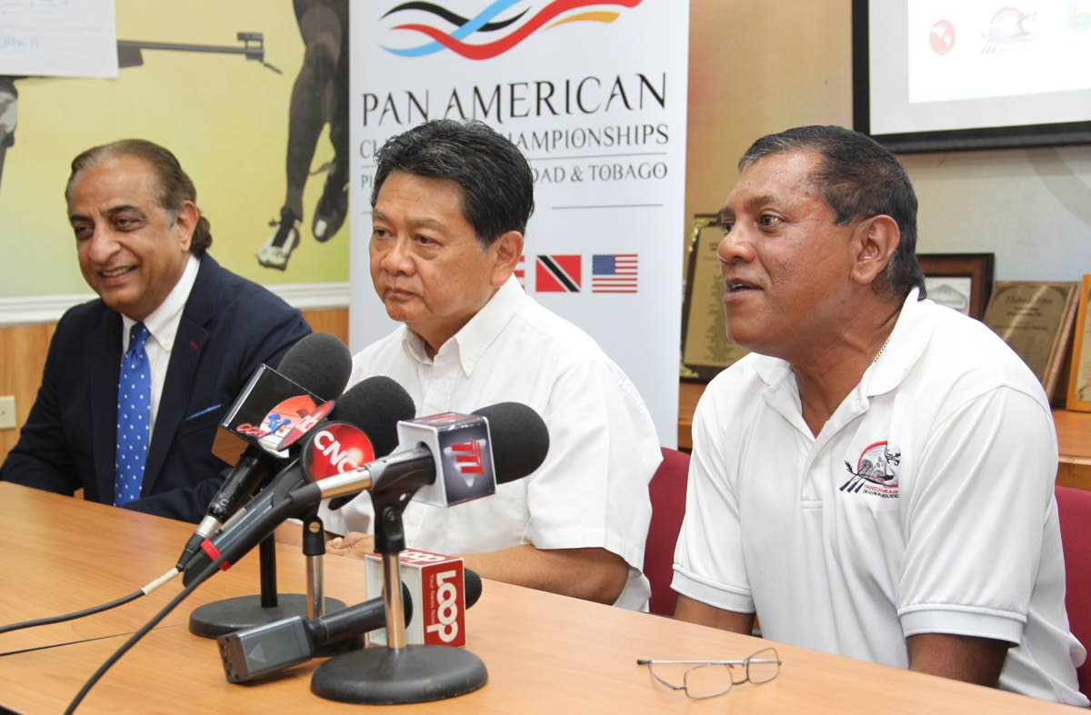 Vinod Bajaj General Manager at Magdalena Grand Hotel ,left, Franco SiuChong president of Pan American Dragon Boat Federation,centre, and Keith Dalip president of the TT Dragon Boat Association speak with the media during the launch,yesterday, of the Pan Am Dragon Boat Club Crew Championships, held at the Olympic House, Abercromby Street, Port of Spain.