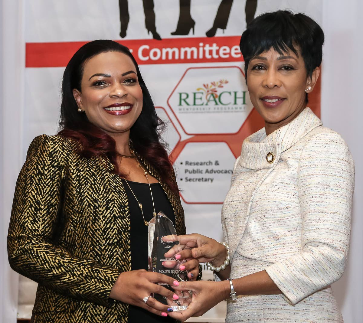 Sharon Rowley (right), wife of Prime Minister De Keith Rowley, presents the Business Pioneer award to Candice Welch, chartered quantity surveyor and director of Welch, Morris and Associates at AFETT Women of Influence Awards and Mentorship function Hyatt Regency, Port of Spain. Photo by Jeff K Mayers