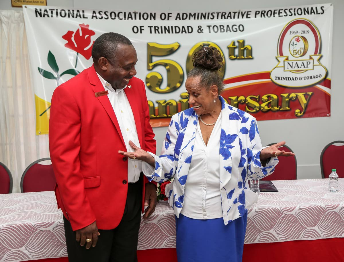 National Association of Administrative Professionals of TT (NAAPTT) founder Grace Talma talks to president Clayton Blackman at the NAPTT launch of Administrative Professional Week 2019 and the organisation's 50th anniversary at the NAAPTT building, Woodbrook in March. PHOTO BY Jeff K Mayers