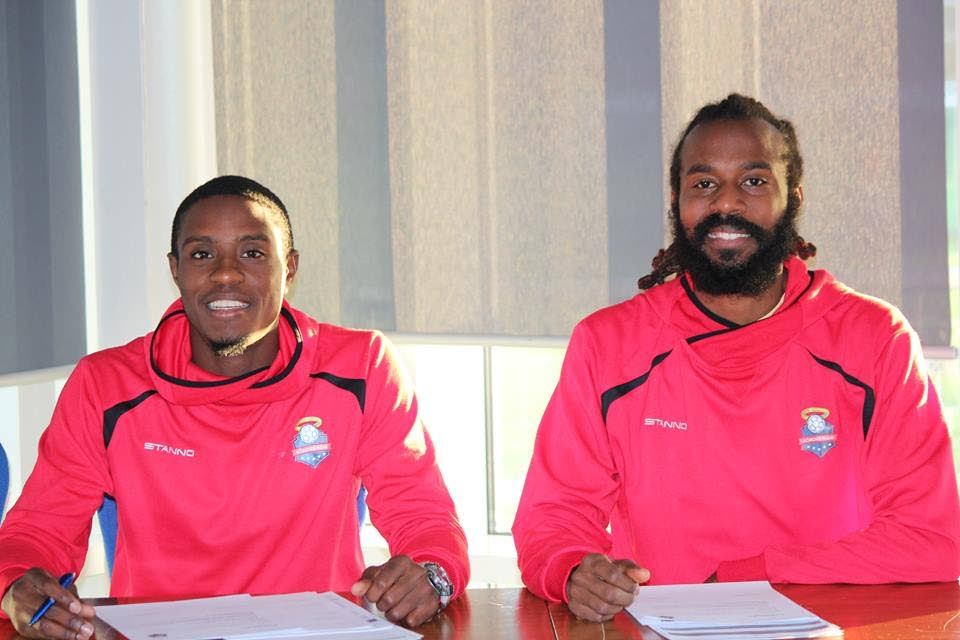 Yohance Marshall (right) and Keston George after they signed their contracts with Iceland club Kordrengir.