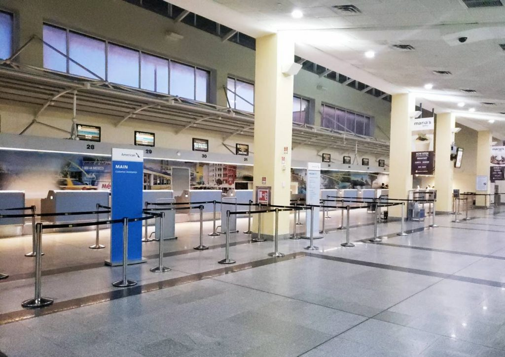 GHOST TOWN: The check-in counter for American Airlines (AA) was deserted yesterday after the airlines primary carries, the Boeing 737 Max 8 aeroplane was ordered grounded by the US Federal Aviation Authority after a Max 8 crashed in Ethiopia last Sunday killing all on board. PHOTOS BY ROGER JACOB