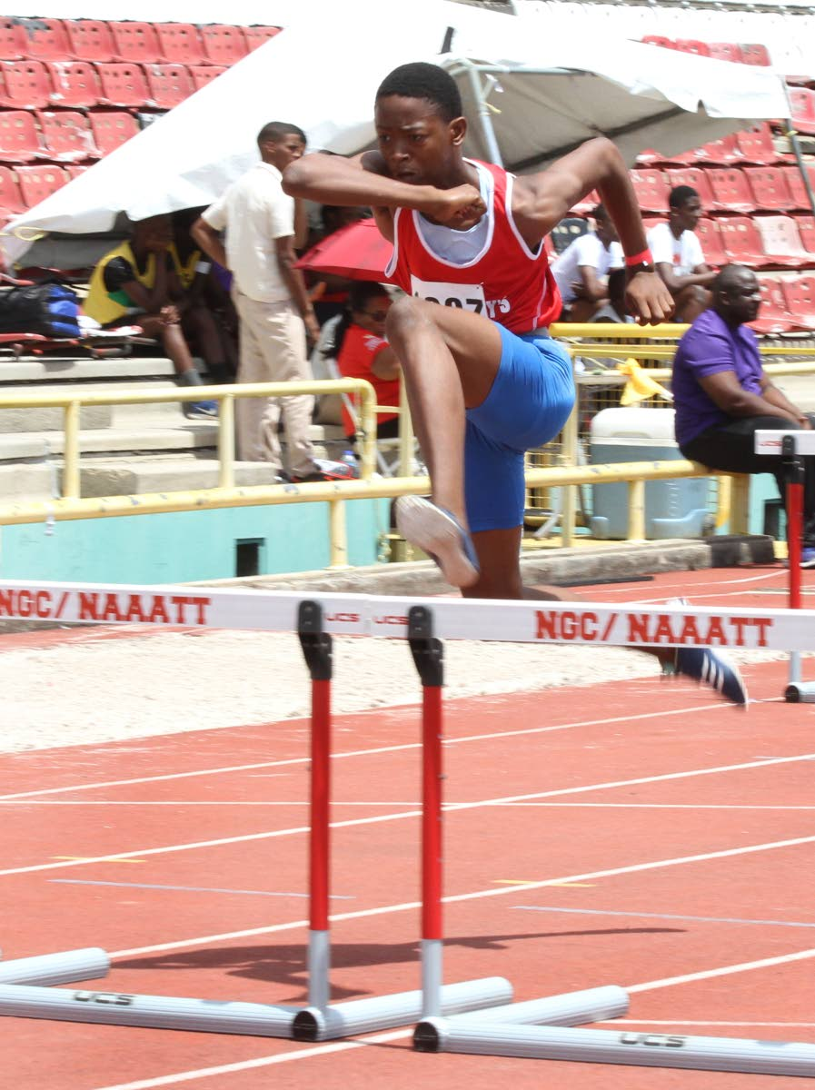Keone John of St Anthony's College, easily wins the U15 100m hurdles,yesterday, at the  National Secondary School's Track and Field Championships, Hasley Crawford Stadium, Port of Spain.