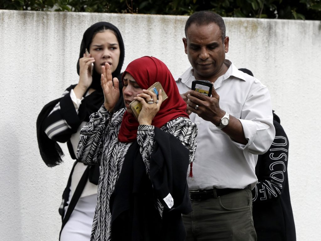 People wait outside a mosque in central Christchurch, New Zealand, Friday, March 15, 2019. Many people were killed in a mass shooting at a mosque in the New Zealand city of Christchurch on Friday, a witness said. Police have not yet described the scale of the shooting but urged people in central Christchurch to stay indoors. AP PHOTO