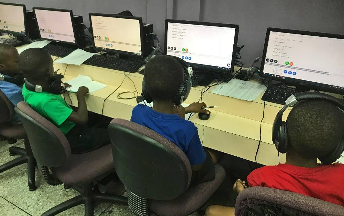 These students of Nelson Street Boys RC have fun while learning through the use of the Arrow learning software.