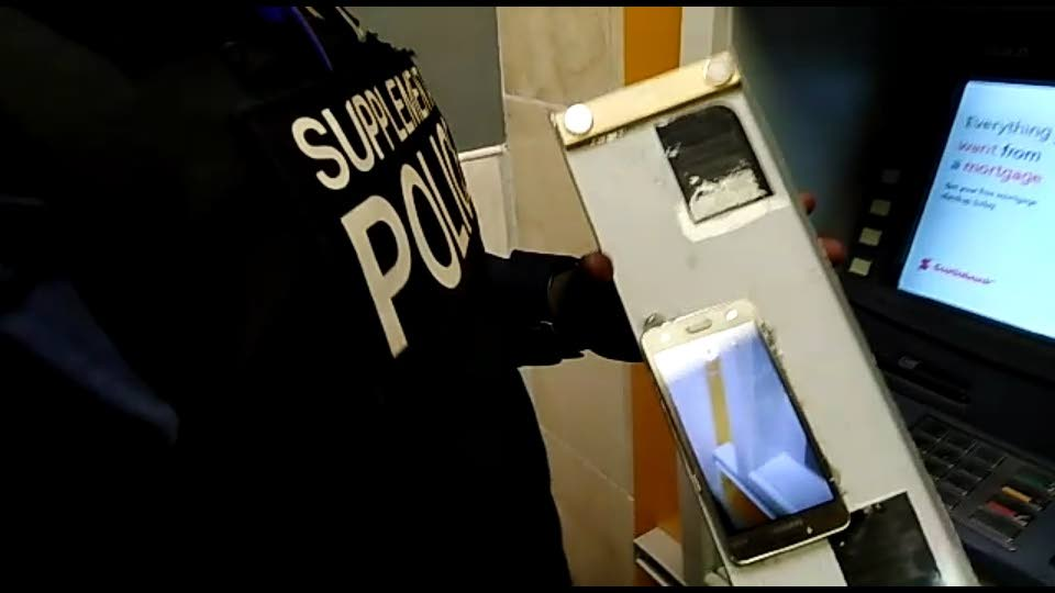 An ATM recording device, which was found at a Scotiabank branch in Freeport