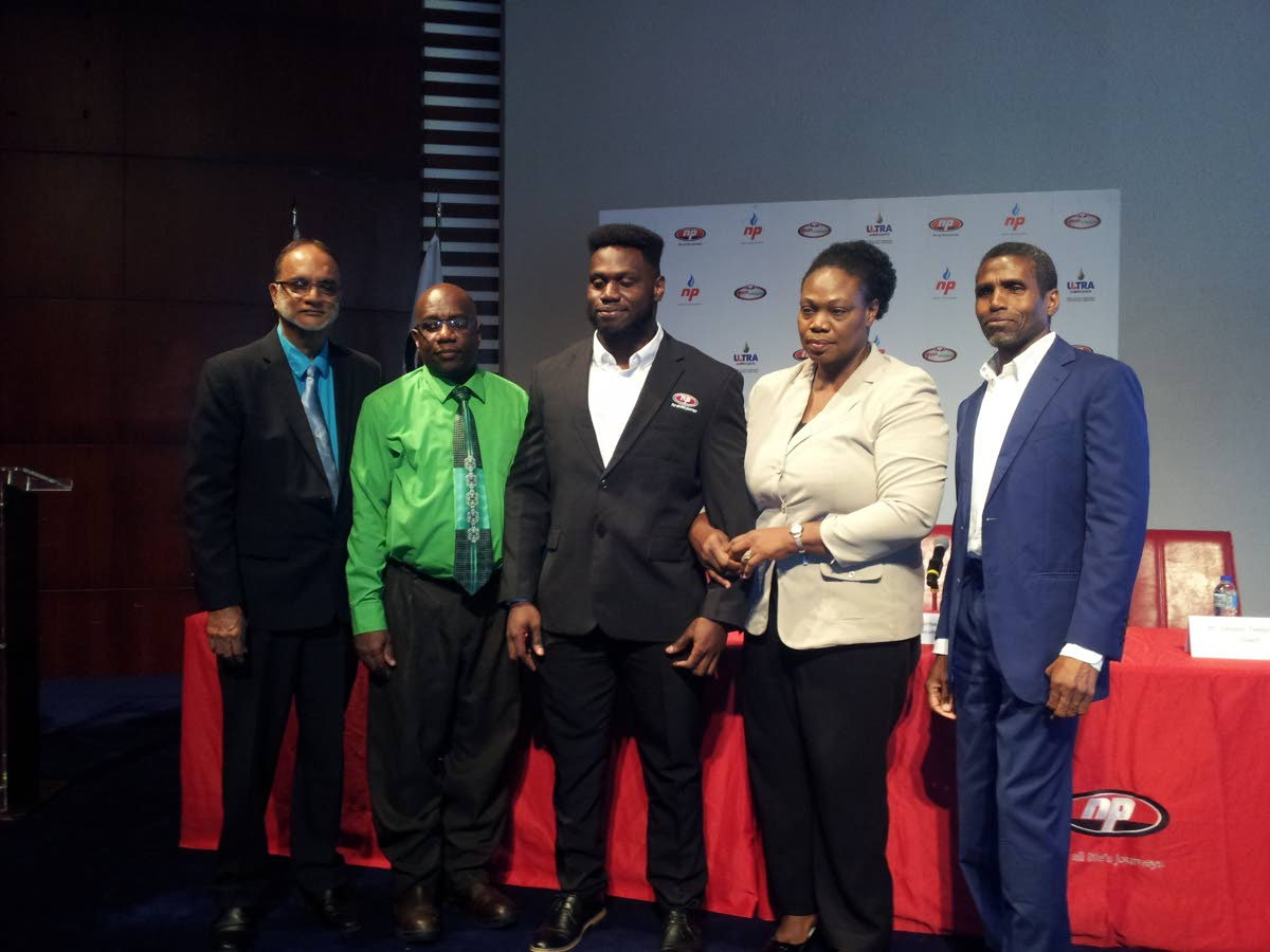 TT powerlifter Rondel Hunte, centre, after becoming a brand ambassador for NP. Also in the photo are NP chairman Sahid Hosein, from left, Hunte's father Ronald, mother Dawn Rodney-Hunte and NP CEO Bernard Mitchell.