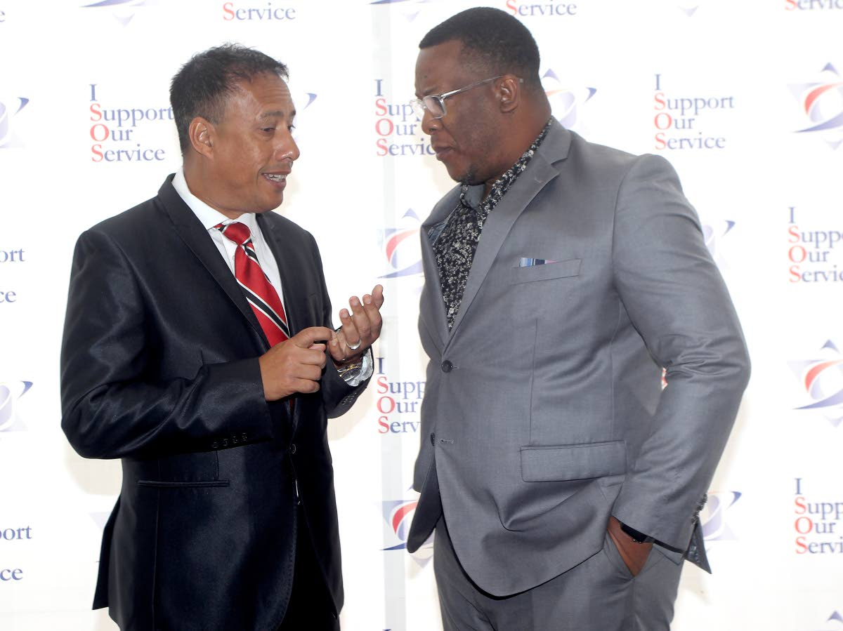 Police Commissioner Gary Griffith and PSSWA president Michael Seales at the launch of the I Support our Service campaign SouthPark Mall, San Fernando on March 15. FILE PHOTO