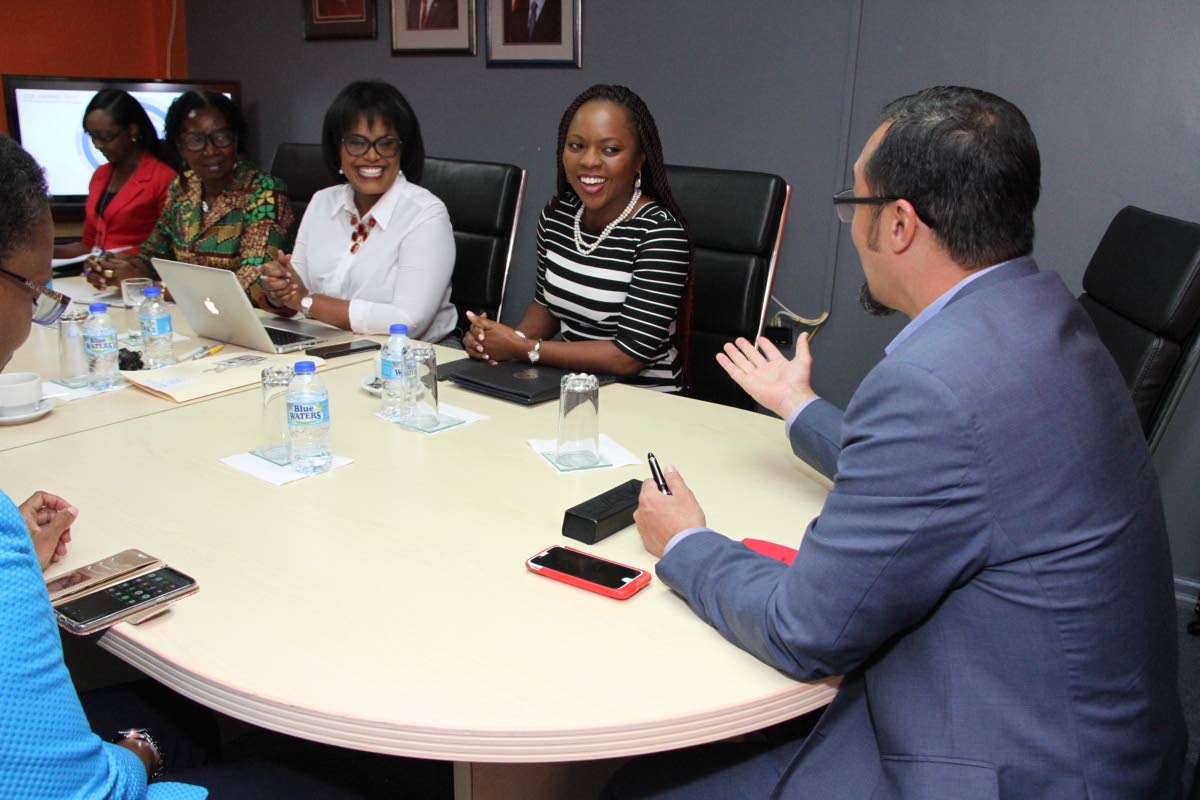Communications Minister Stuart Young at a meeting with TTT officials.