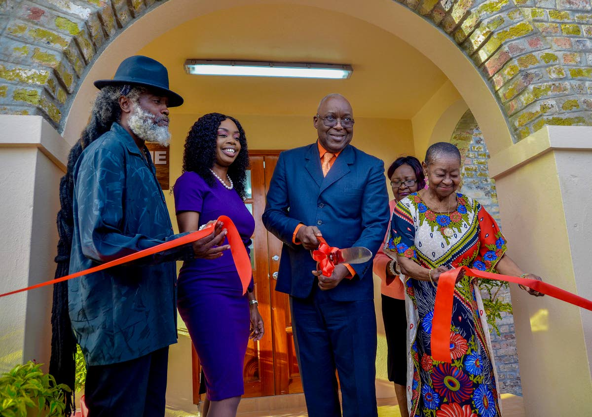 Chief Secretary Kelvin Charles, centre, cuts the ribbon to open the Icons of Tobago Museum, which will feature the works of Calypso Rose, right, and the late Winston