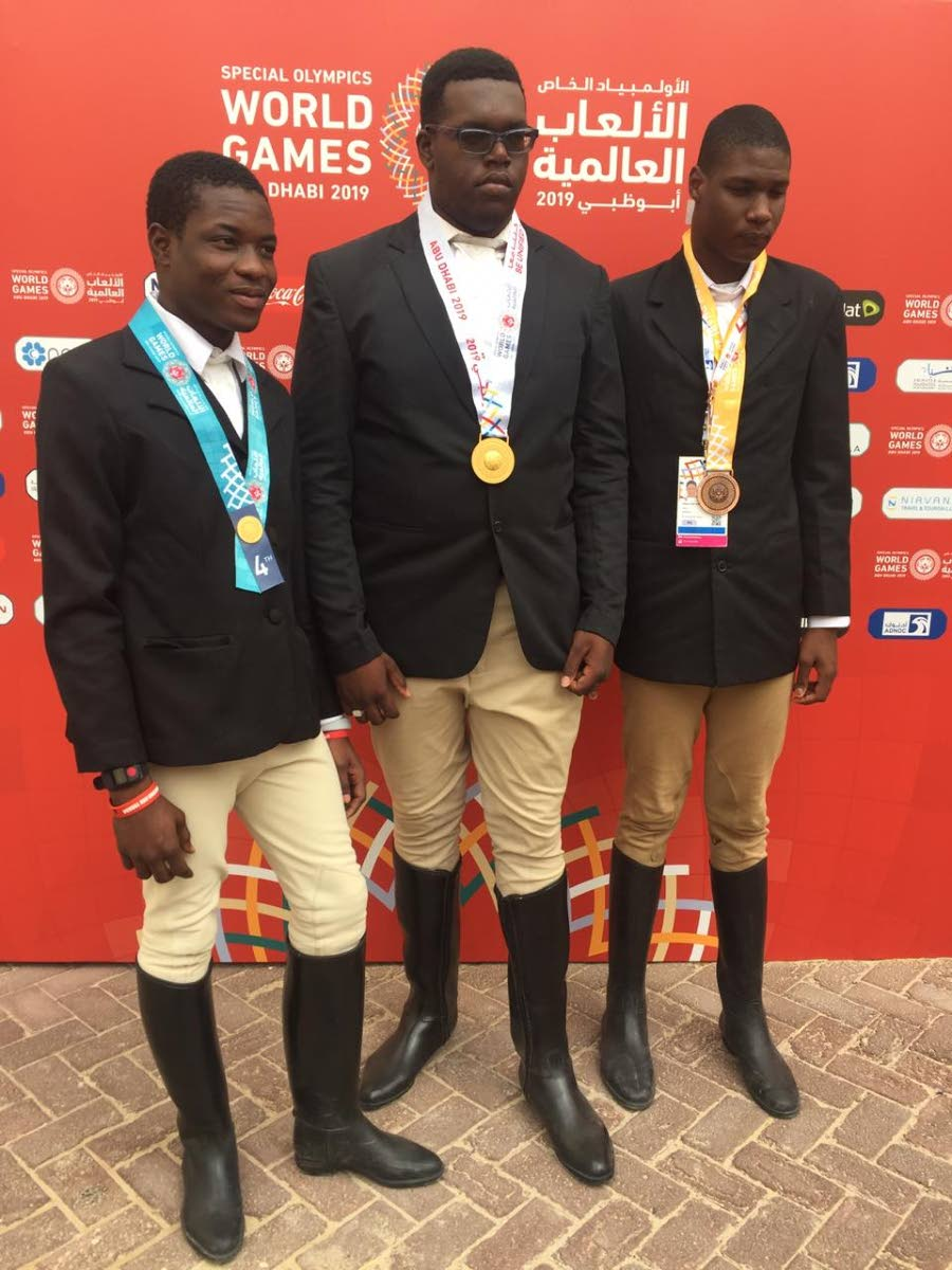 Equestrian athletes (from left) Romaldo Stafford, Aaron Ben Ali and Omari Peterson won medals yesterday for Special Olympics TT at the World Games.