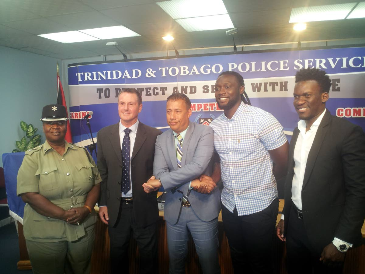 Police Commissioner Gary Griffith, centre, at the launch of the Commissioner's Cup, yesterday. Also in the photo are assistant Commissioner of Police, community relations, Patsy Joseph, from left, technical director of Football Factory Terry Fenwick, former TT footballer Kenwyne Jones and TT Football Association general secretary Camara David.