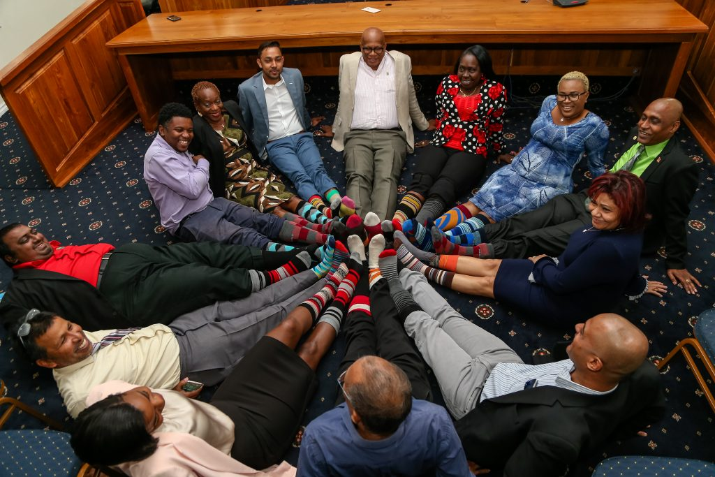 San Fernando mayor Junia Regrello, deputy mayor Vydia Mungal-Bisessar along with aldermen and Councillors of the San Fernando City Corportation show off their colored socks to raise Down Syndrome awareness at the mayor's office in San Fernando.