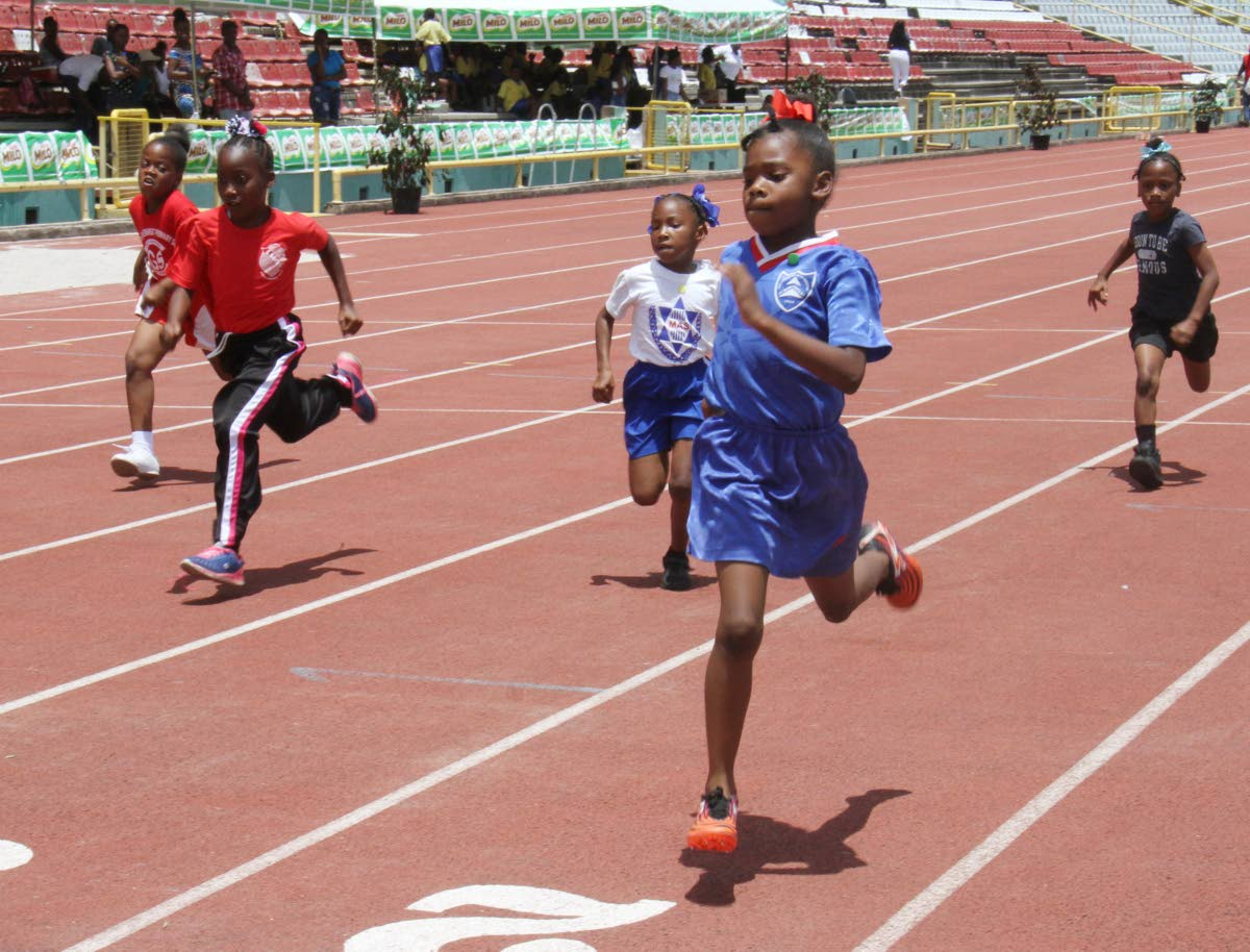 Jennaya Granderson, of St. Dominic's RC Primary, 2nd from right, goes on to win the Girls Under 9, 80m, at the 32nd Kelvin Nancoo (Milo) Primary Schools Games, Hasley Crawford Stadium, Woodbrook.