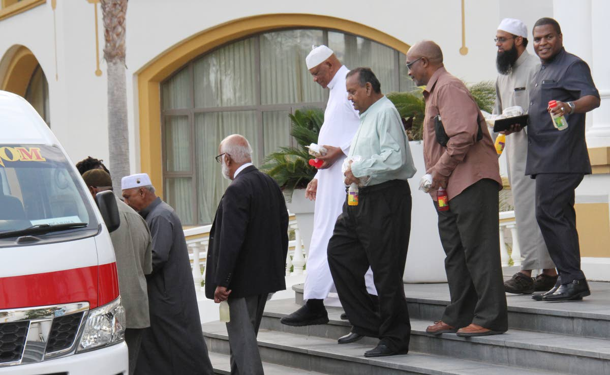 Muslim leaders leave the Diplomatic Centre in St Ann's yesterday after a meeting with the prime minister.