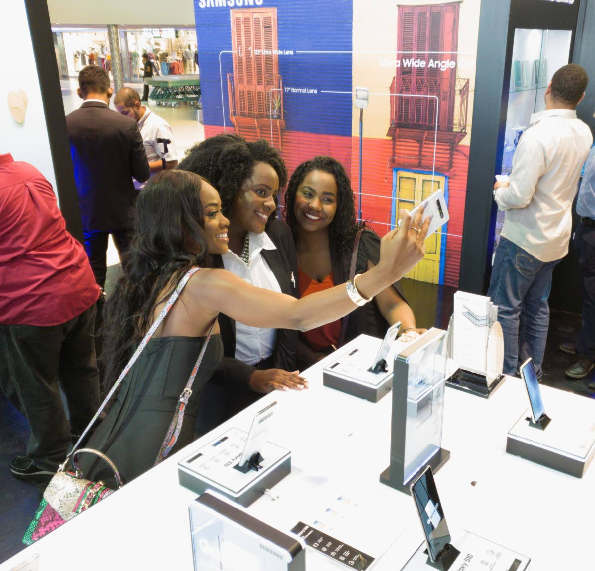 Samsung brand ambassador Avionne Mark, Experience team member Hadassah Gordon, and Rhesa Lessey pose for a wefie with the new wide-angle S10 front facing lens at the launch, Gulf City, La Romaine. PHOTO BY MARK LYNDERSAY   Photo by Mark Lyndersay.