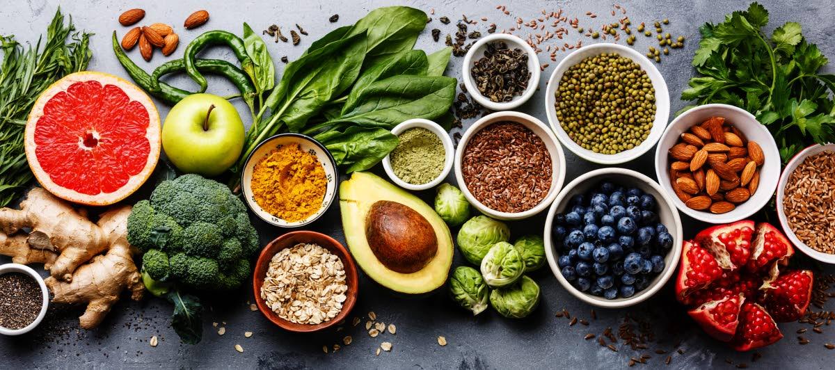 Healthy food clean eating selection: fruit, vegetable, seeds, superfood, cereal, leaf vegetable.