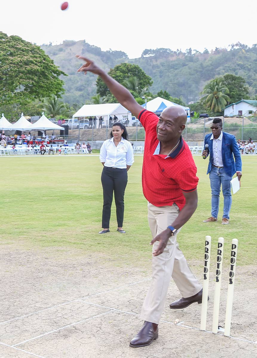 FULL TOSS: Prime Minister Dr Keith Rowley sends down a full toss as he bowled the first ball yesterday at the opening of the Diego Martin sporting complex. PHOTO BY JEFF MAYERS