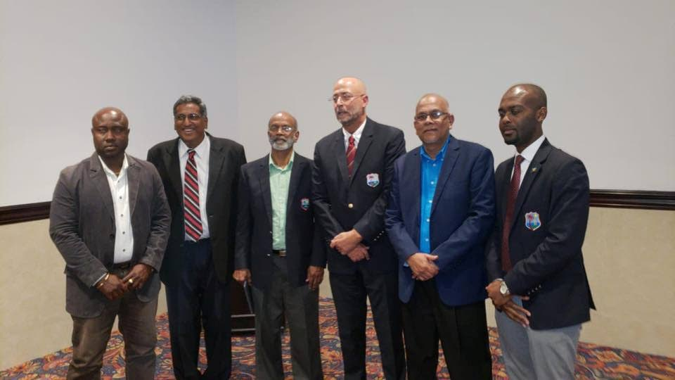 Newly-elected CWI president Ricky Skerritt (third from right) and vice-president Dr Kishore Shallow (right) pose with TTCB president Azim Bassarath (second from right), TTCB treasurer Sukesh Maniam (second from left) and TTCB general secretary Arjoon Ramlal (third from left) after yesterday's elections. PHOTO COURTESY TT CRICKET BOARD.