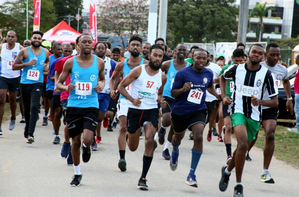 Runners participate in the CariFin Savannah One Lap, on Wednesday, at the Queen's Park Savannah.