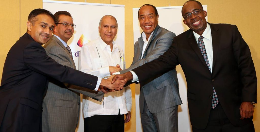 In this November 30, 2015 file photo, from left, GHL Group CEO Ravi Tiwarie, director Imtiaz Ahamad, GHL chairman Arthur Lok Jack, National Commercial Bank (NCB) chairman Michael Lee Chin and NCB CEO Patrick Hilton shake hands after announcing NCB's acquisition of 29.9 per cent of GHL shares at Hyatt Regency, Port of Spain.