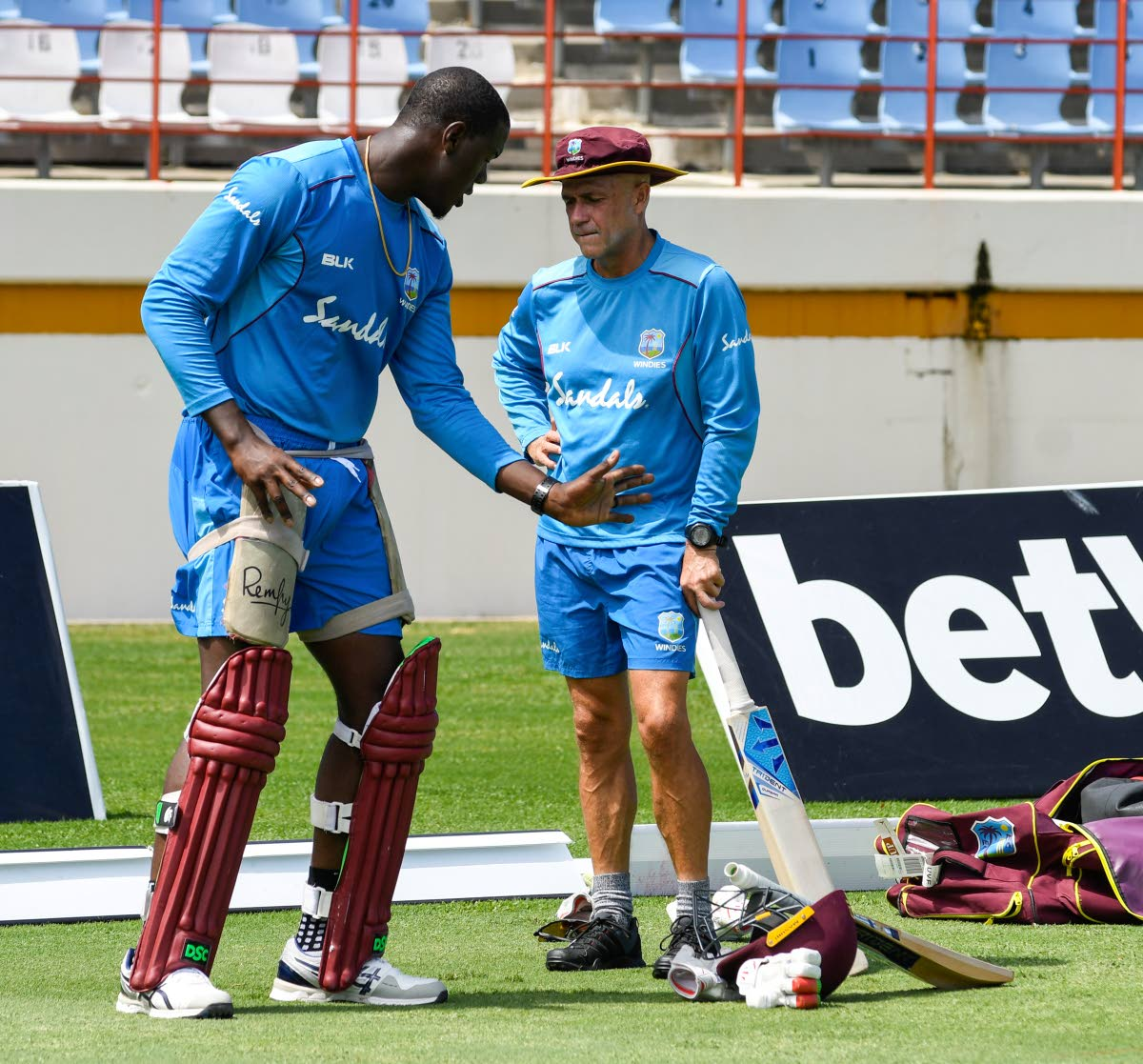 In this file photo, Carlos Brathwaite (L) and Richard Pybus (R) of West Indies take part in a training session one day ahead of the first T20I between West Indies and England, at the Darren Sammy Cricket Ground, Gros Islet, Saint Lucia,on March 4. AFP PHOTO