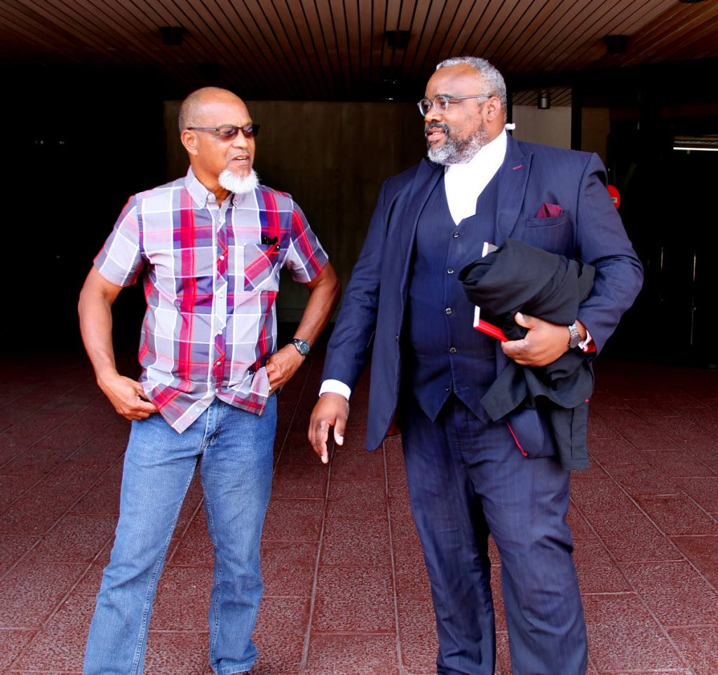 FLASHBACK : In this March 20 file photo, Super League president Keith Look Loy, left, and his attorney Matthew Gayle chat at the Hall of Justice, Port of Spain, after he scored a victory against the TT Football Association. PHOTO BY SUREASH CHOLAI