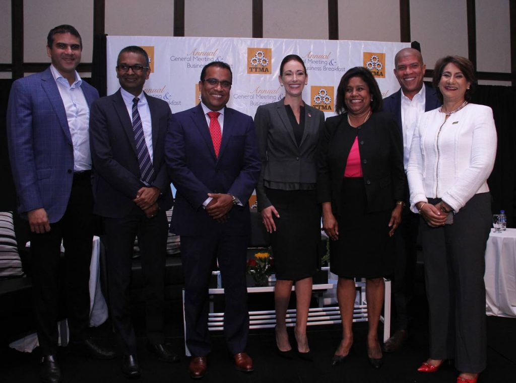 Minister of Trade and Industry Paula Gopee-Scoon, third from right, with, from left, Nicholas Lok Jack, executive director, Asscoiated Brands Industries Ltd; Richard Seeteram, head of Supply and Chain for the Anglo-Dutch Caribbean, Nestle; Joel Pemberton, CEO, DeNovo Energy Ltd; newly elected president of the TT Manufacturers' Association (TTMA) Franka Costelloe; Gregory Hannays, partner, Ernst and Young; and Karen Darbasie, group CEO First Citizens Bank at TTMA's AGM Business Breakfast meeting yesterday, at the Hilton Trinidad and Conference Centre, Port-of-Spain.