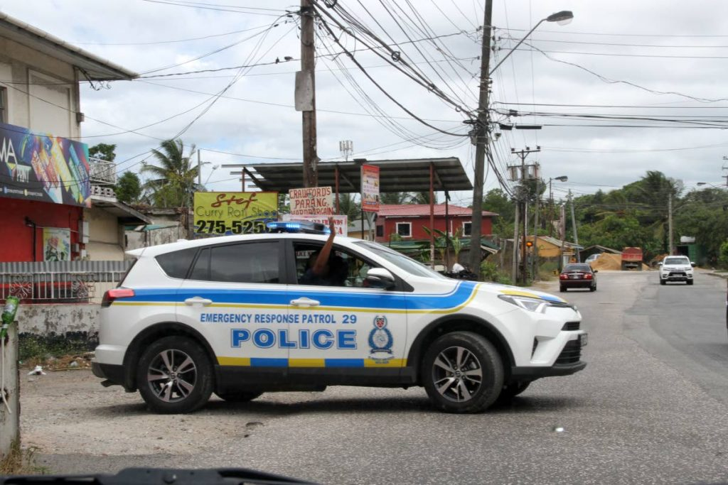 Police leave Old Train Line, Claxton Bay, where one of their vehicles was found abandoned after being stolen from officers yesterday.