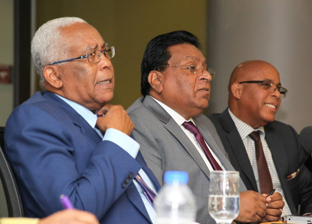 From left: Education Minister Anthony Garcia; Harrilal Seecharan, chief education officer; and Professor Dennis Conrad, manager of Student Support Services discuss the Secondary Entrance Assessment (SEA) examination at a media conference at the Ministry of Education,  Port of Spain, yesterday.