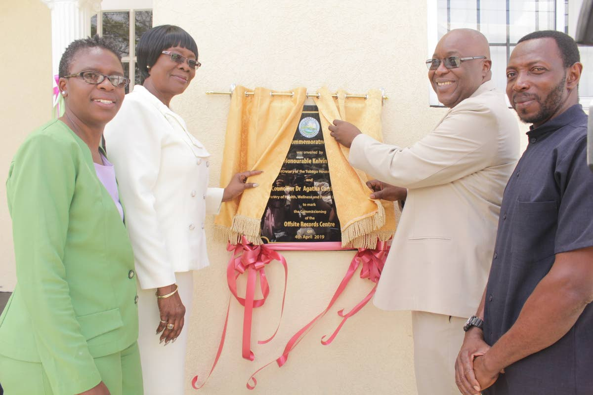 Everyone all smiles at the unveiling of the commemorative stone to mark the event. From left: Mrs. Dianne Baker-Henry, Administrator in the Division of Health, Wellness and Family Development; Councillor Dr. Agatha Carrington, Secretary of Health, Wellness and Family Development; Honourable Kelvin Charles, Chief Secretary of the THA and Pastor Ellis Clarke of the Scarborough New Testament Church of God