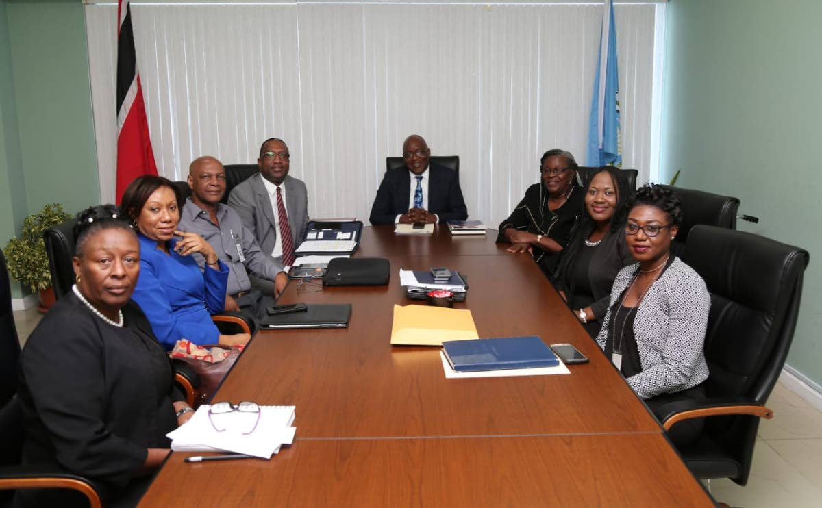 Chief Secretary Kelvin Charles, centre, held discussions recently on a University of Tobago.