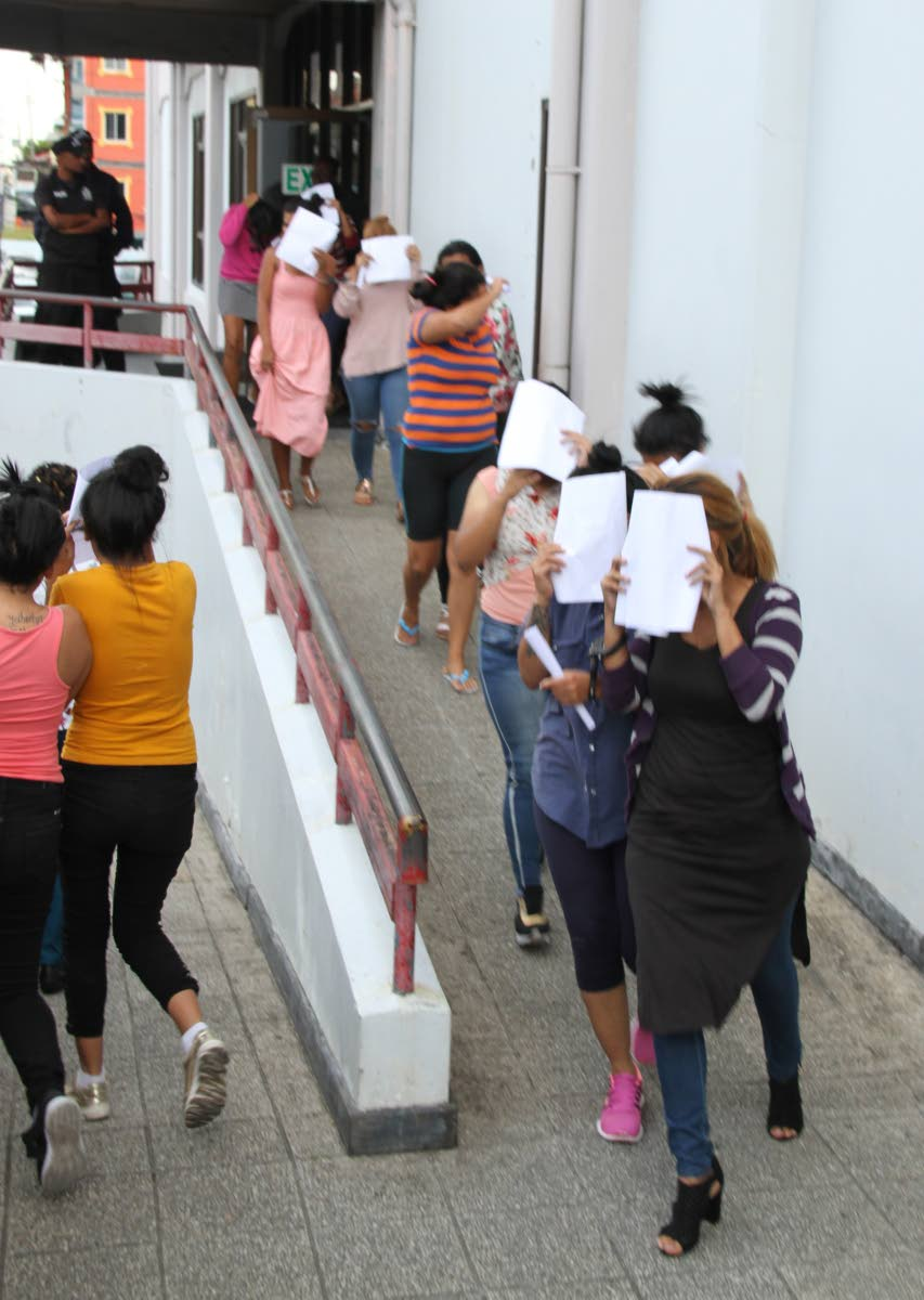 Venezuelan women leave the San Fernando High Court on Friday after being fined for illegal entry. PHOTO BY VASHTI SINGH