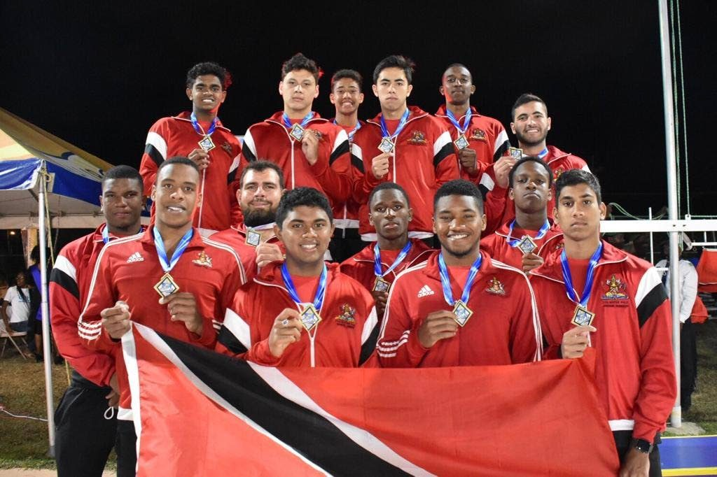 TT's 19 and under water polo team display their gold medals after winning their category this past weekend, at the Carifta 2019 Water Polo Championships, in Barbados.