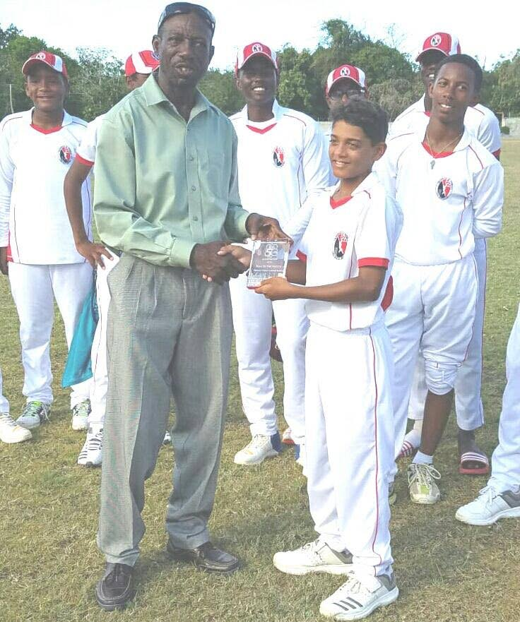 Joshua Davis (centre) collects his Man of the Match award from a CWI official after Sunday's match.  PHOTO COURTESY CRICKET WEST INDIES.