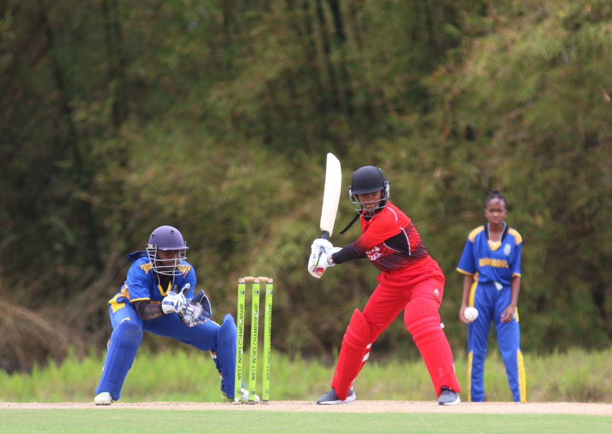 A TT batswoman looks to play a shot, yesterday, during action in the Cricket West Indies TT Women's Cricket Association Girls 19 and Under T20 Tournament match against Barbados, at the National Cricket Centre, Couva.