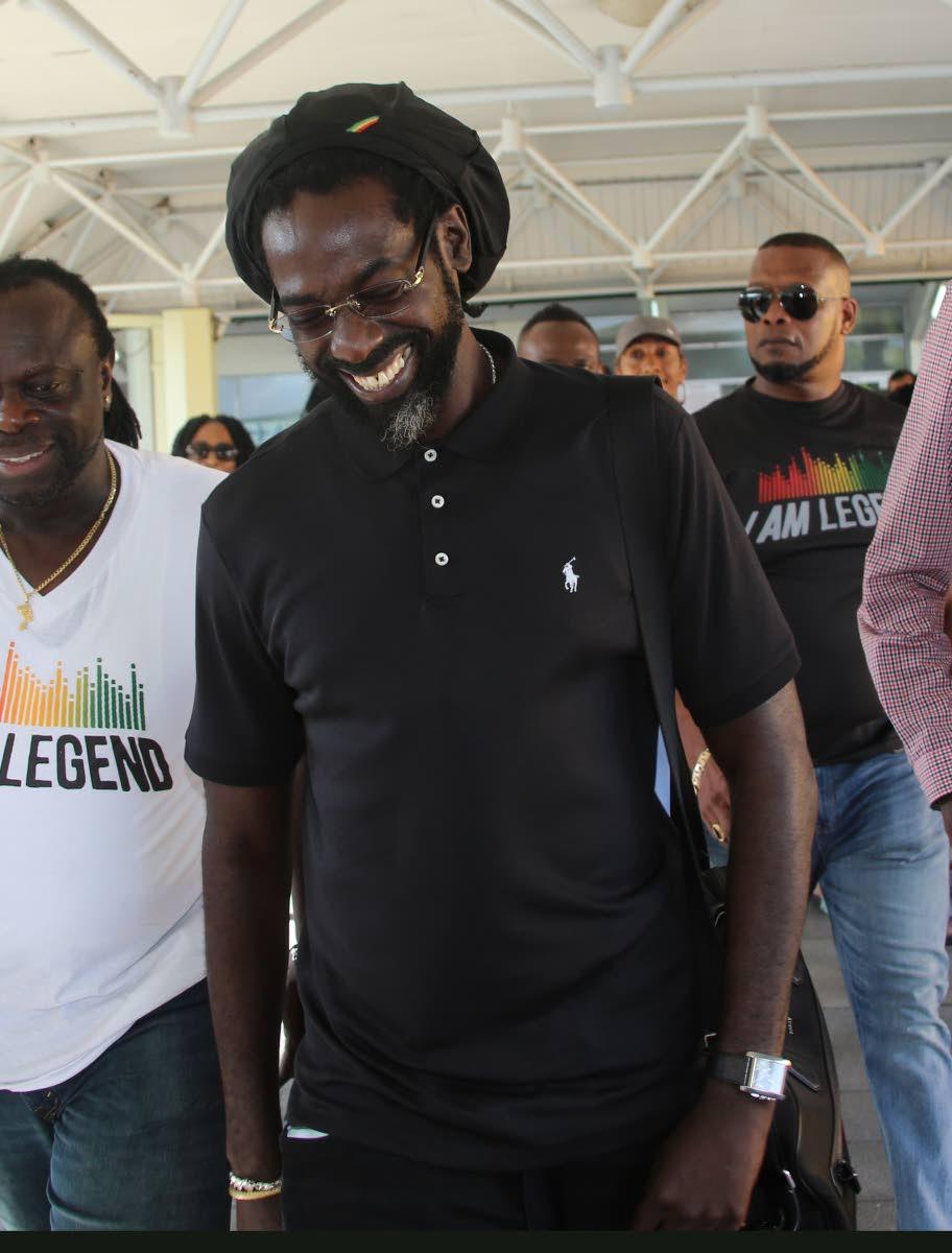 Jamaican reggae artiste Buju Banton arrives at the old Piarco airport yesterday.   Photos: Sureash Cholai