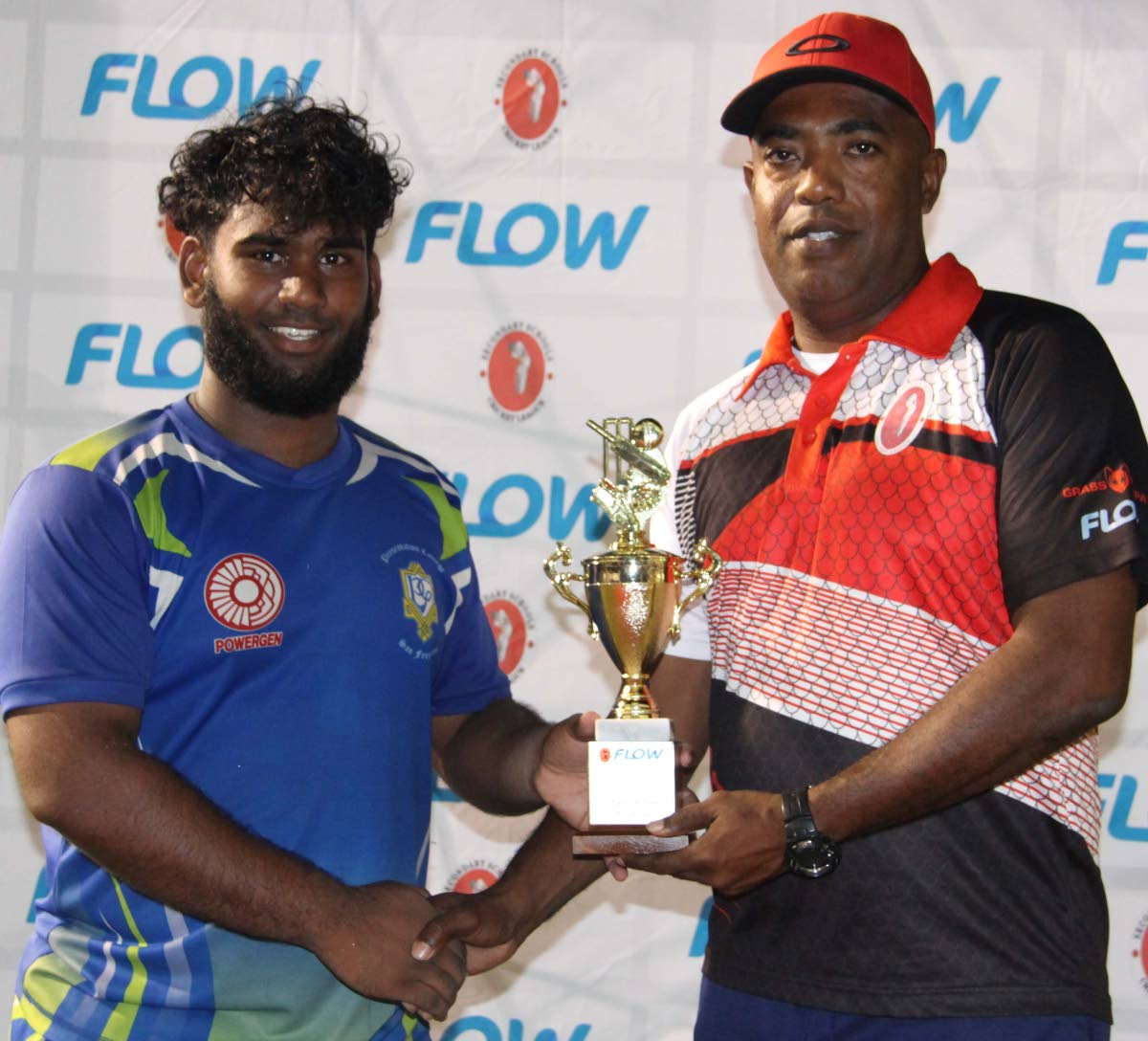 Presentation College's Sanjay Jawahir, left, collects a prize for Best Bowler from Secondary Schools Cricket League PRO Anib Forgenie. PHOTO BY VASHTI SINGH