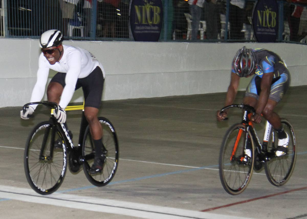 Nicholas Paul, left, wins the Keirin Finals International/Invitational 3 lap race, in the Madonna Wheelers Easter Grand Prix, on Friday evening, at the Arima Velodrome.