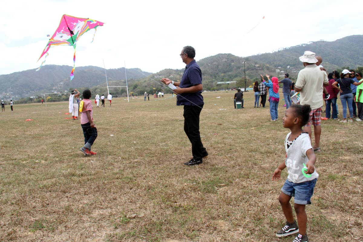 KITE PILOT:  Three-year-old Kelise Dyer focused intently on flying her kite yesterday at the Queen's Park Savannah.   PHOTO BY ANGELO MARCELLE