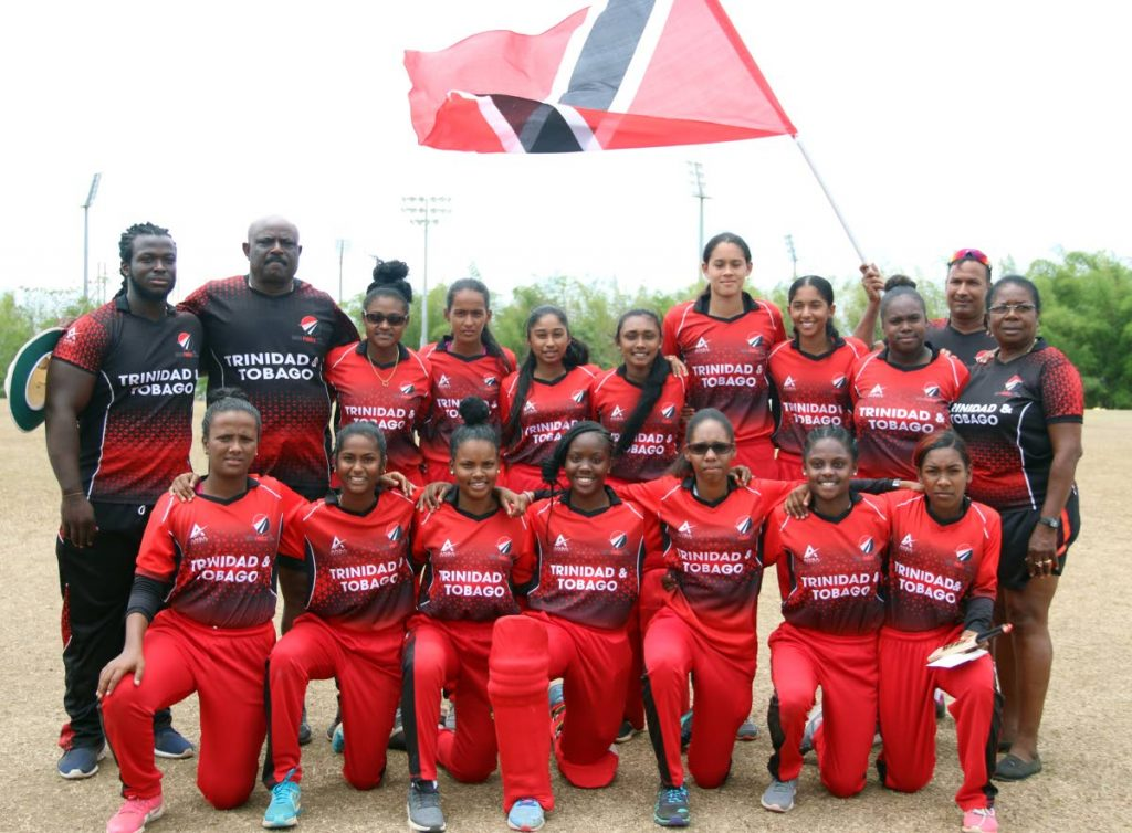 The national women's under-19 team with their coach and technical staff after winning the regional tournament at the National Cricket Centre, Couva, yesterday. PHOTO BY ANSEL JEBODH