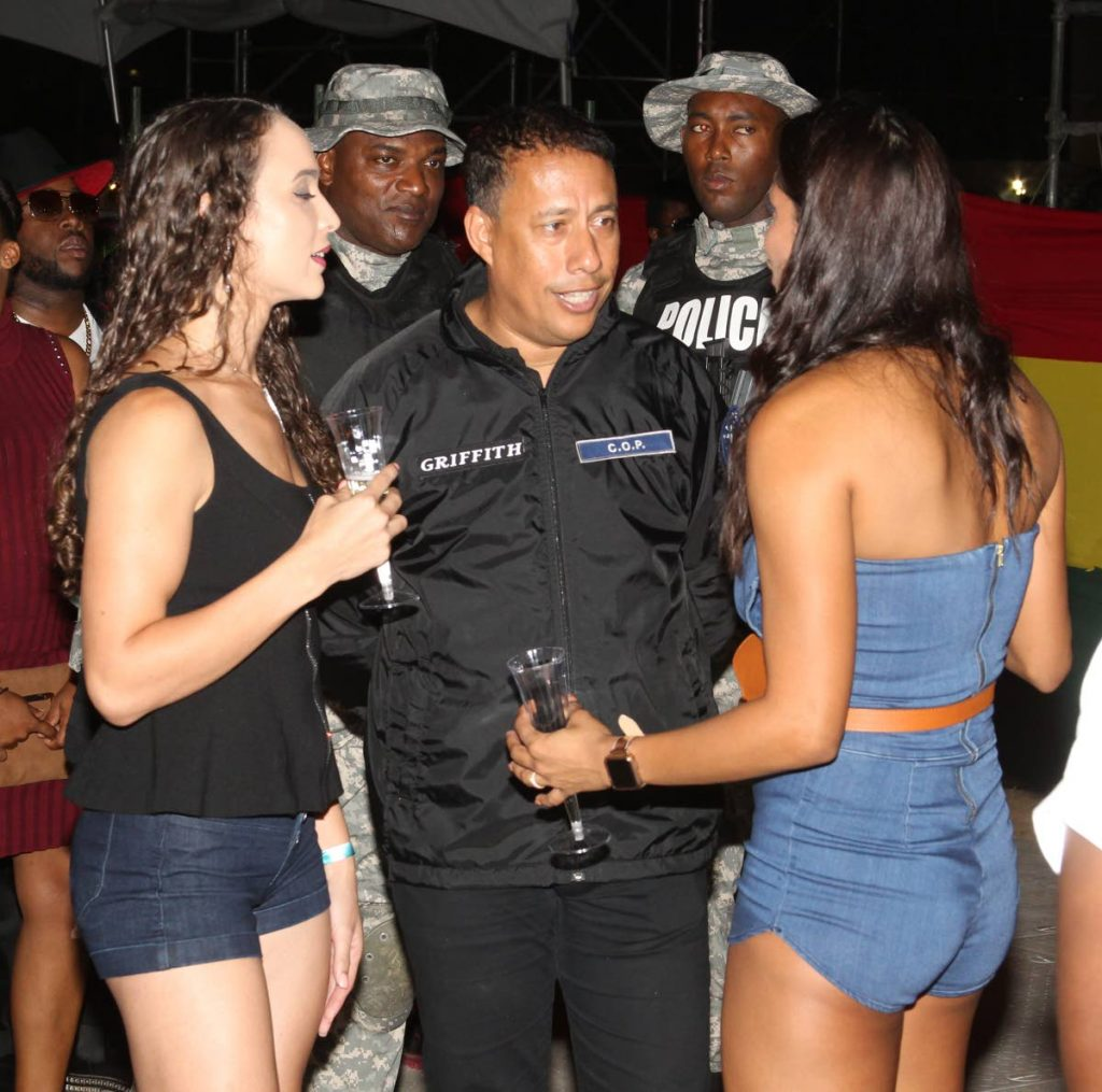 CENTRE OF ATTENTION: Commissioner of Police Gary Griffith was the centre of attention by these two women at the I Am Legend concert at Queen's Park Savannah, Port of Spain Sunday night. PHOTOS BY ROGER JACOB