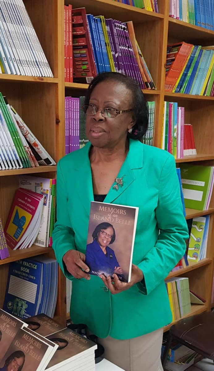 Naomi Modester shows a copy of her new book, Memoirs of an Island Belle, which details life growing up in a small Tobago village.