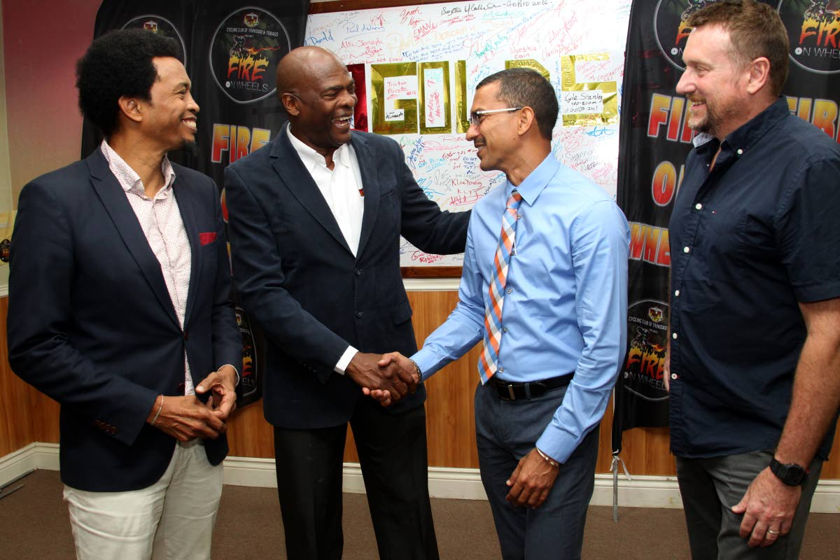 (L-R) Brian Lewis, president of TTOC, Desmond Roberts CEO of PSL, Marcus Girdharie, managing director of Marjen Financial and Erin Hartwell, National Technical Director for Cycling chat, at the Olympic House, Abercromby Street, PoS yesterday, during the launch of the PCL Cycling Club's Fire on Wheels due to be held on June 1 and 2.