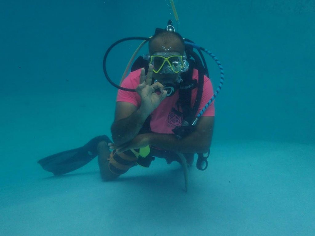 A-OK! Dive Instructor Zameer Rahaman shows off the standard diving signal for