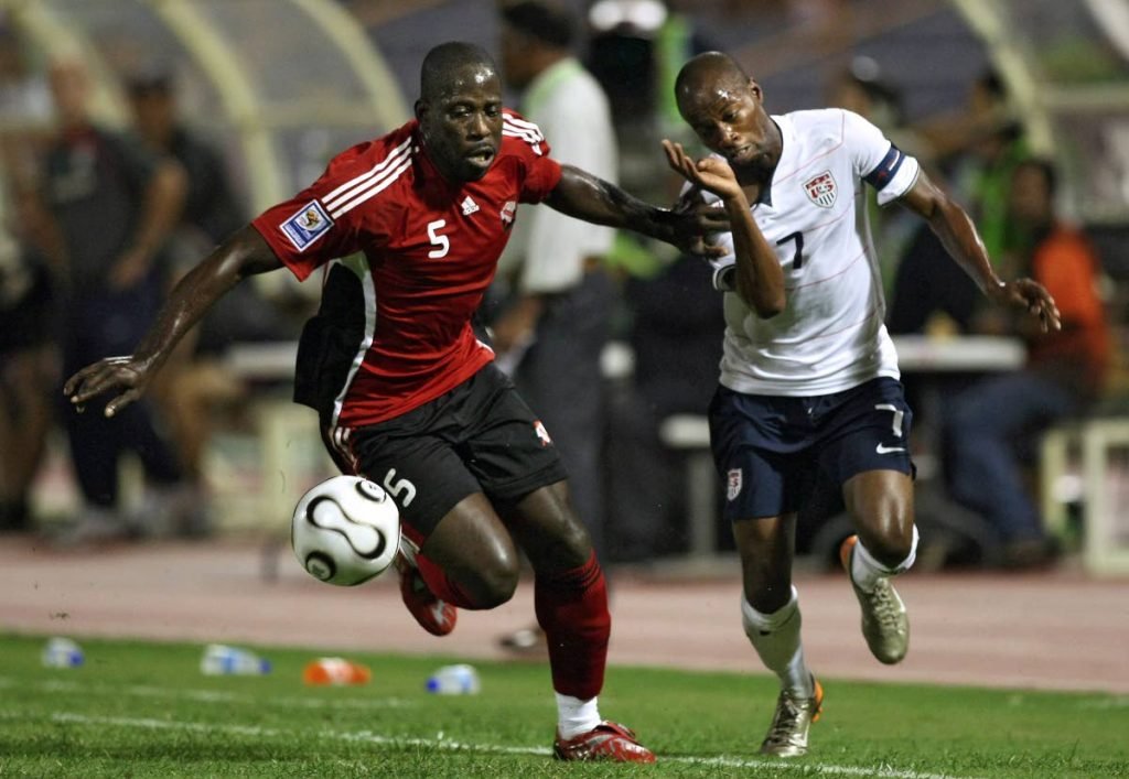 In this October 15, 2008 file photo, US midfielder DaMarcus Beasley (right) vies for the ball with TT defender Keyeno Thomas during their FIFA World Cup South Africa 2010 qualifier at the Hasely Crawford Stadium, Mucurapo.