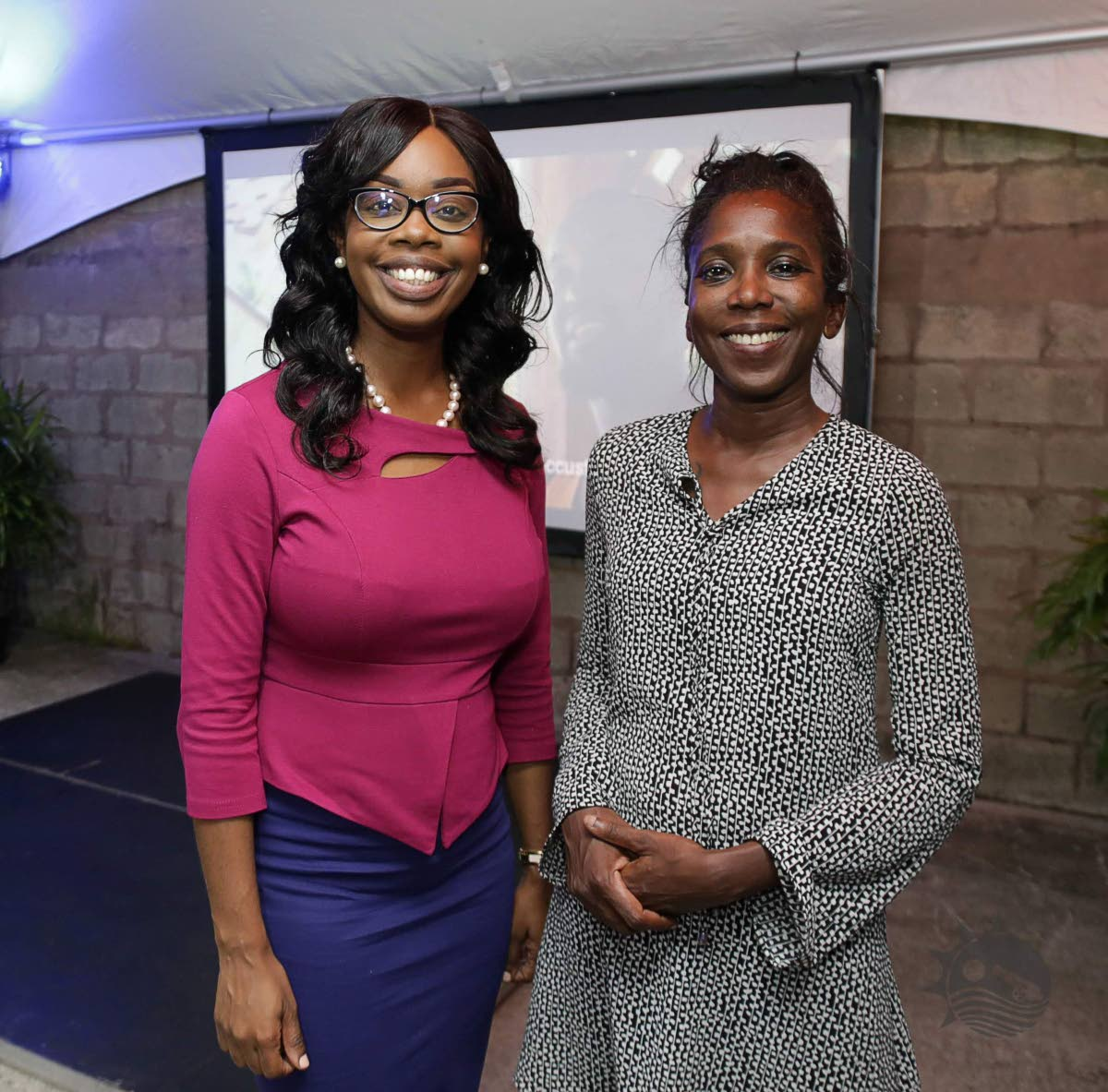 Nadine Stewart-Phillips, Secretary for the Division of Tourism, left, with Melvina Harvard, programme facilitator at the launch of the Tobago Rural Film Initiative last Wednesday at the division's compound Sangster's Hill, Scarborough.  Photo by THA