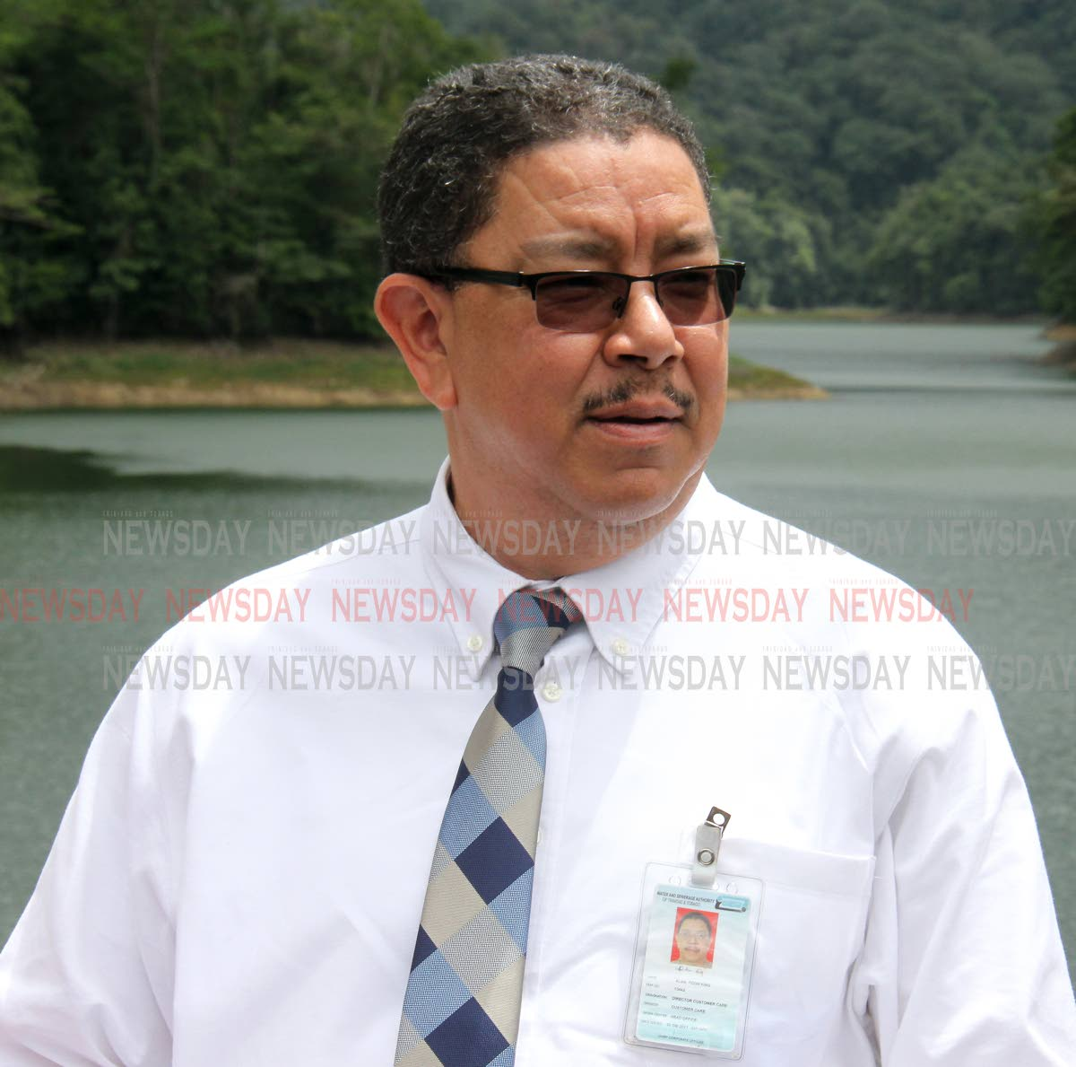 Director, Customer Care (Ag.), Alan Poon-King, speaks to the media at Hollis Dam, Valencia. Photo by Angelo Marcelle