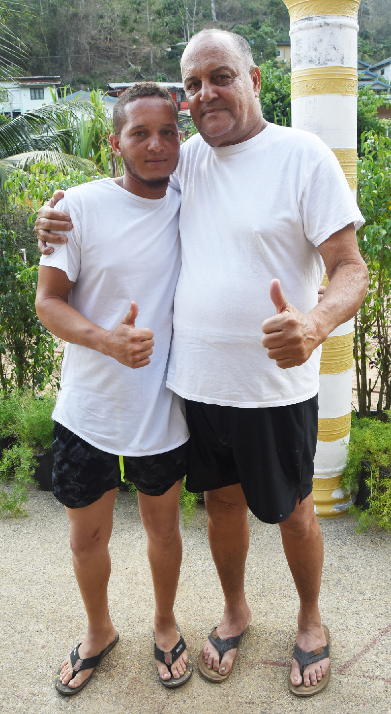 GRATEFUL: Christopher Bugros and his father Anthony at their Saut D'eau Road, Maraval home on Saturday.