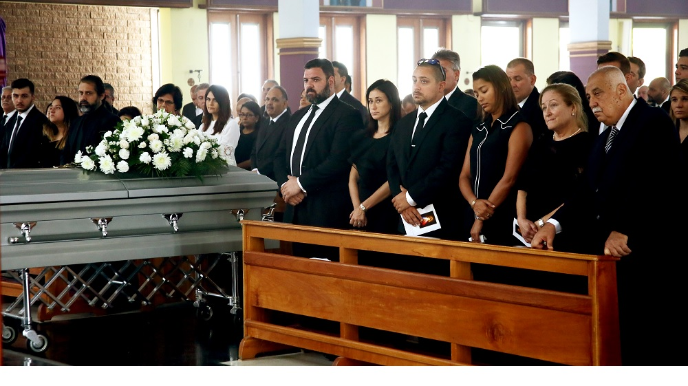 Family and friends of the late Richard Fakoory, chairman of the TT Pro League, stand during his funeral yesterday, at the St Finbar's RC Church, Diego Martin. Fakoory died last Wednesday. He was 71.